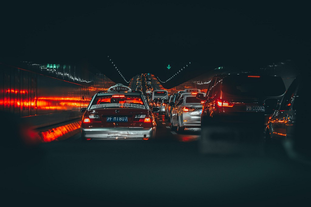 Cars in dark tunnel. Photo by Hanny Naibaho on Unsplash